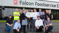 CHAS' Sarah Dannfald accepted the cheque from Steve Stenhouse of Falcon.