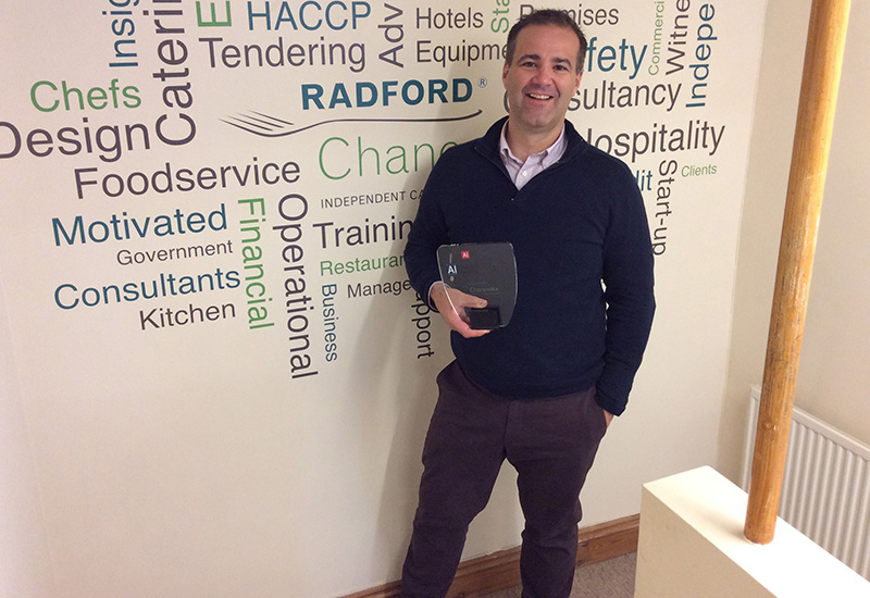 Radford Chancellor with his consultancy's latest trophy.