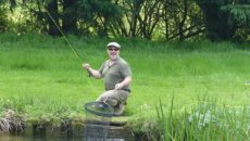 Keith Baldwin of Bravilor was pleased with his catch during the 2016 Trout Fishing Day.