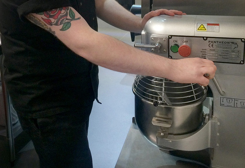 A Pantheon PM20 mixer in use within a school kitchen.