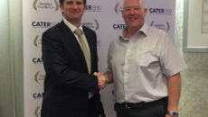 Caterbar chairman Henry Stephenson welcomes Highland Industrial Supplies' hygiene and catering divisional manager John MacPherson into the buying group.