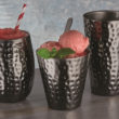 The 12oz. and 16oz. Tumblers and a 14oz. Mule Cup in a hammered black mirror finish.