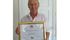 Bryan Whittaker MBE with the BSI Distinguished Service Certificate.
