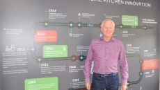 Advance Group non-executive chairman and founder Steve Coates with the company's timeline.