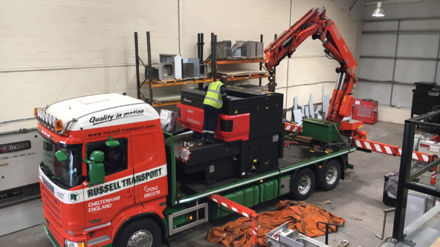 C&C Fabrications' new laser cutter in the process of being delivered.