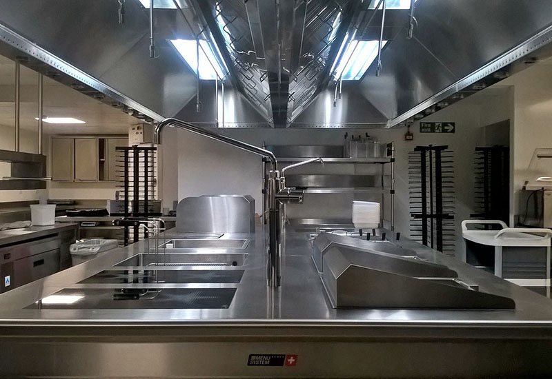 HCE's RAC Club kitchen design is crowned by Exclusive Ranges' Menu System Premium induction cooking suite.